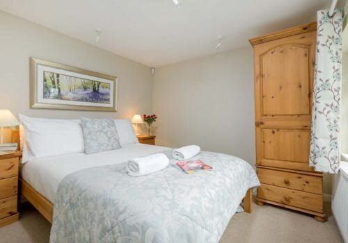 Self Catering Cottage new Forest Downstairs bedroom with view of garden Beck Cottage