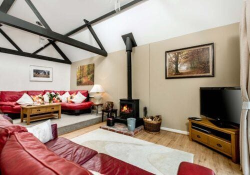 New Forest Self Catering Red Sofa Lounge area Criddlestyle Cottage