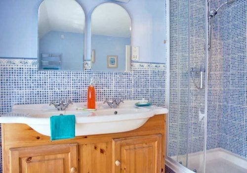 The Farm House En-suite with mosaic style wall tiles