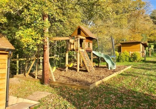 Mews Hill Children's play area with woodchip ground around the climbing frame