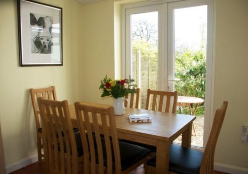 Dining table for 6 at Oaktree Cottage looking out towards the garden