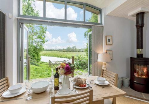 Dining table with flowers and a stunning view across the River Avon
