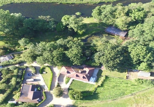 Aerial view of holiday homes by the river