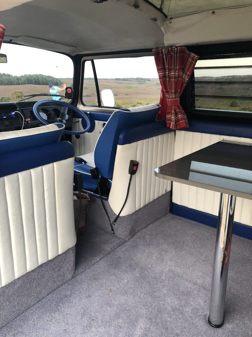 Front seats and table in rear of the campervan