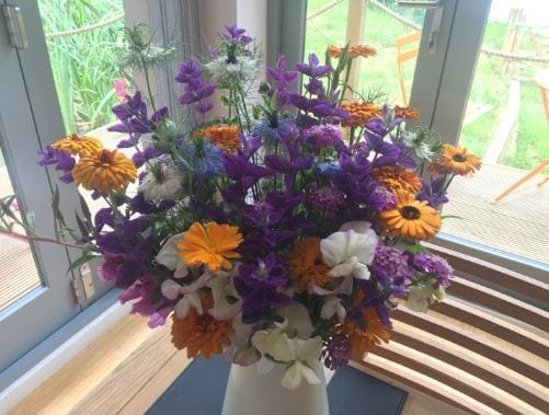 A beautiful fresh bouquet of country flowers awaits our guests