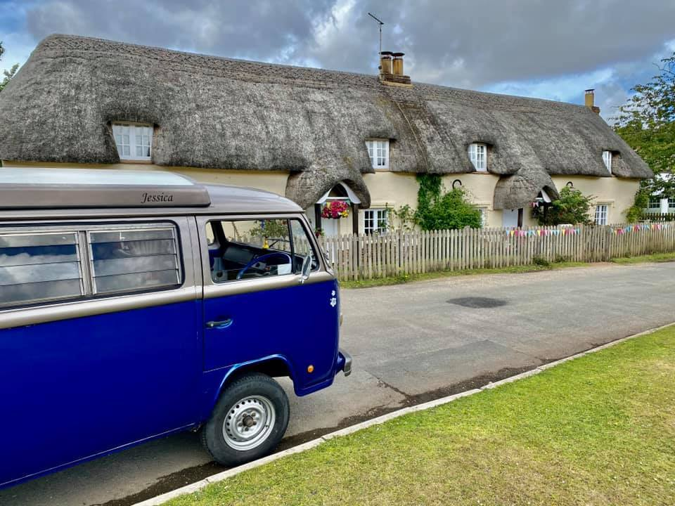 V W camper van and new Forest Thatched Cottage