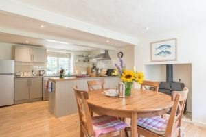 Kitchen and dining area in dog friendly countryside Dorset holiday cottage - Old Post Office Cottage