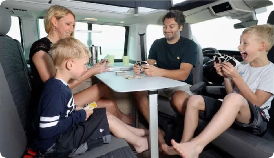 A family enjoying a holiday in a Southampton rented campervan.