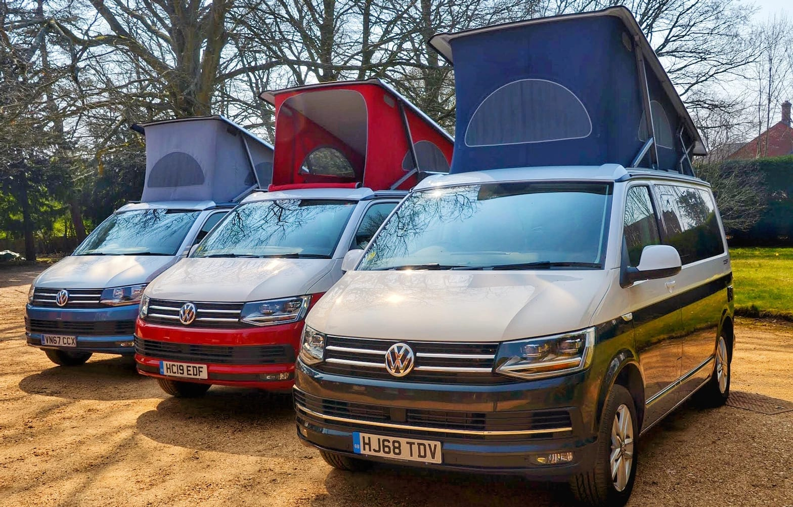 A row of 3 different VW campervans available for hire from Southampton campers.
