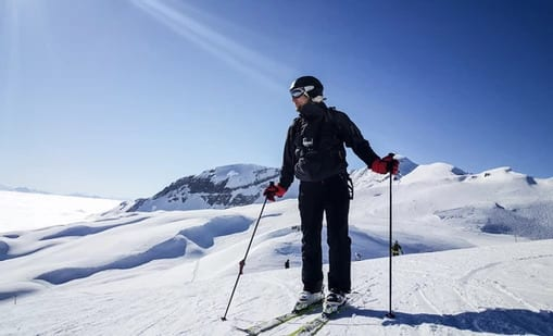 A man skiing down the mountains on the French Alps.