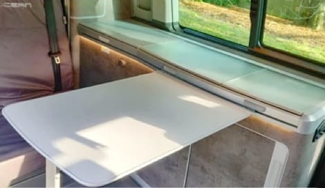 Photo of the pull out table inside of a VW campervan.