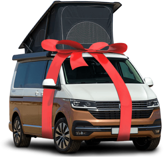 A studio image of a two tone VW campervan with a red bow tied around it.